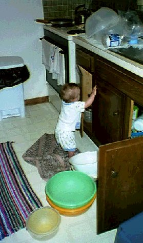Uh-Oh, Joshua found the cupboards!
